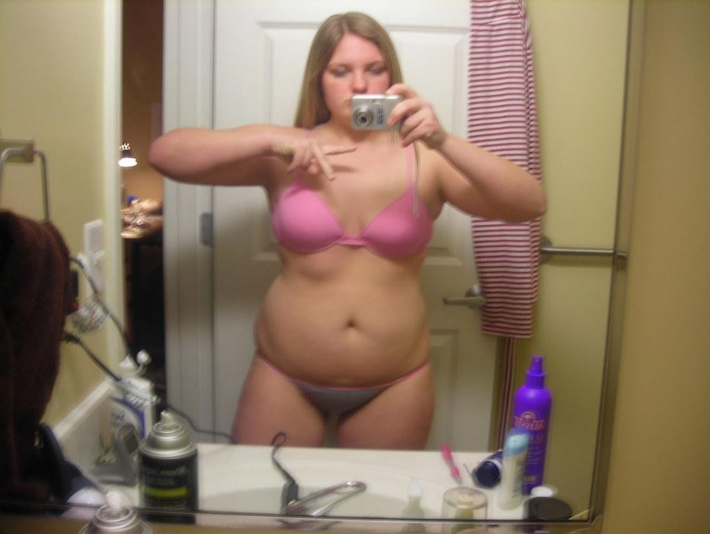 Chubby naked girl in mirror